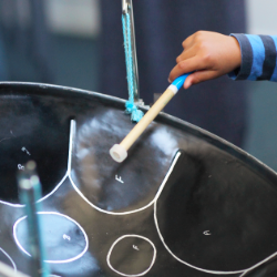 Child playing a steel drum
